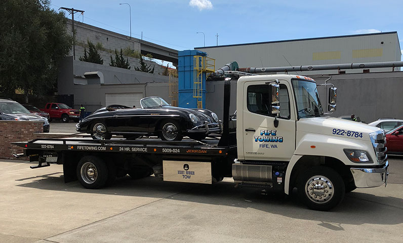 Flatbed Tow Truck Towing A Classic Car